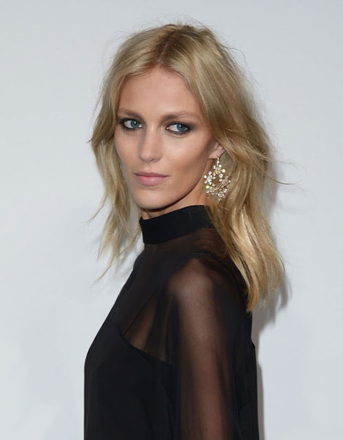 Anja Rubik in diamond earrings and a ring by Chopard