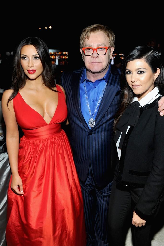 Kim Kardashian in Celia Kritharioti and Sir Elton John with Kourtney Kardashian in Saint Laurent.