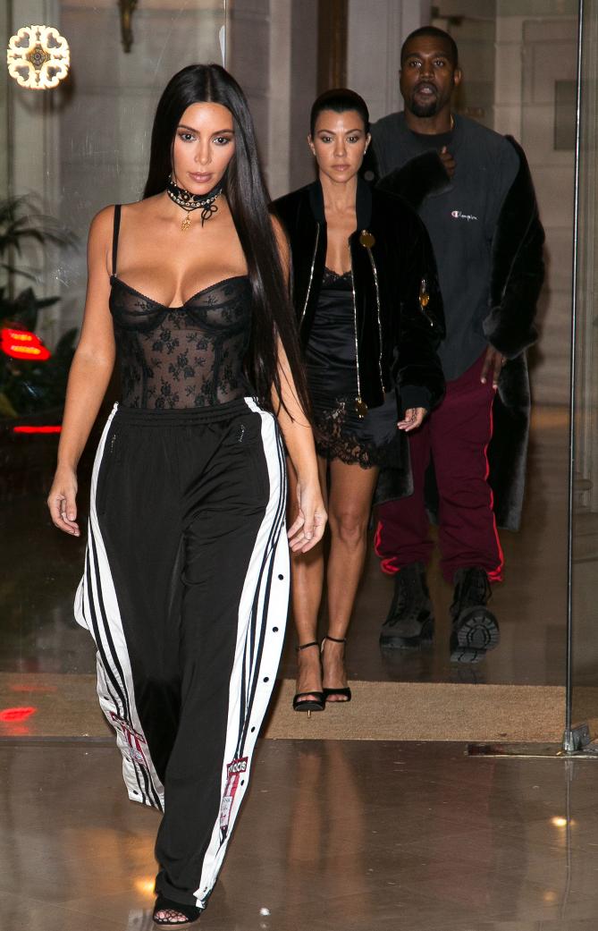 PARIS, FRANCE - SEPTEMBER 29: (L-R) Kim Kardashian West, Kourtney Kardashian and Kanye West leave the 'Givenchy' office on September 29, 2016 in Paris, France. (Photo by Marc Piasecki/GC Images)